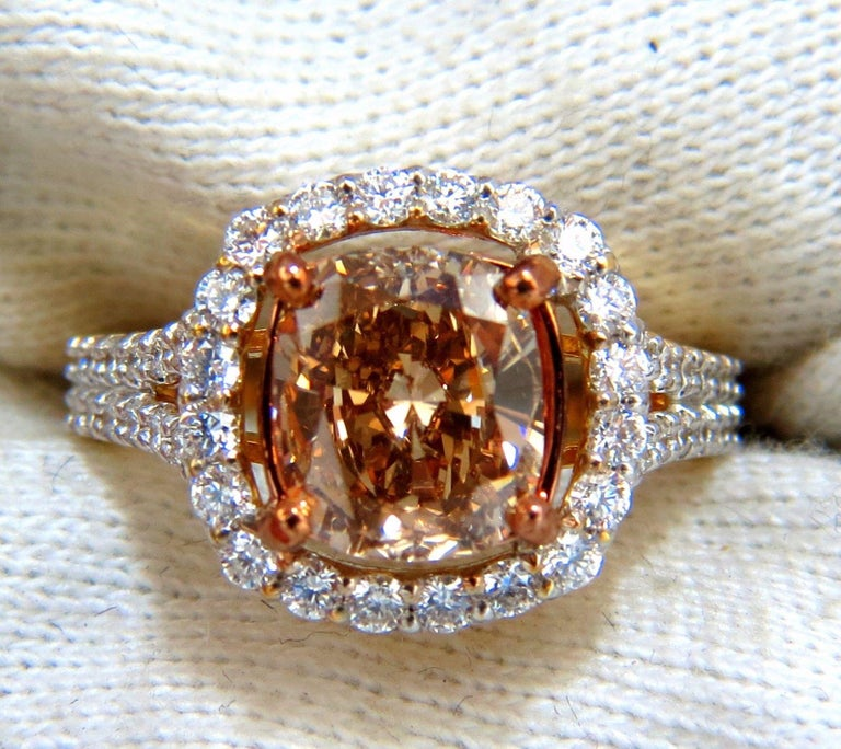 Everlasting Beauty  GIA 2.23ct Natural Fancy color  diamond ring.  Cushion, Brilliant  Natural, Fancy Brown Yellow, Even  Vs2 clarity  Report Id: 2181151677  Please see attached photo for report.   .76ct. side round , full cut diamonds.  G-color