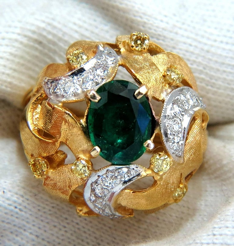 European Florentine Interwined  1.35ct. Natural Emerald Ring  9 X 7mm  Transparent & Vivid Green   .28ct. natural yellow Diamonds.  .45ct. white diamonds.  Round & full cuts   G-color Vs-2 clarity.    14kt. yellow gold  11.6 grams  Ring Current