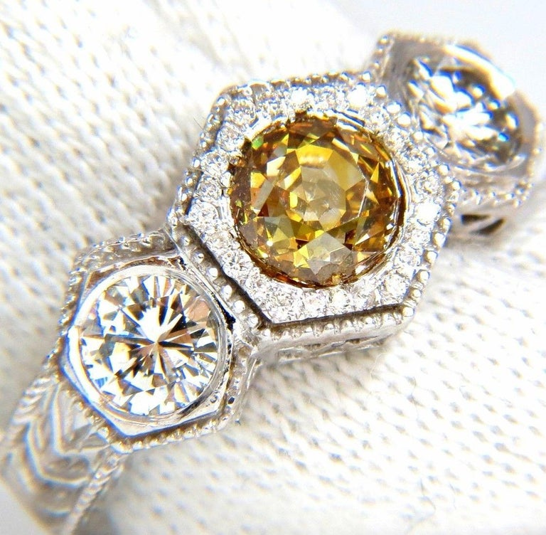 Edwardian Classic Threes  GIA Certified: 1.36Ct Natural Fancy Yellow Brown European cut round diamond ring.  Report # 2155624773  Stating: Fancy Brownish Yellow   Si-1 clarity.   (No visible black inclusion).    .84ct. Side round (2) cut diamonds  &