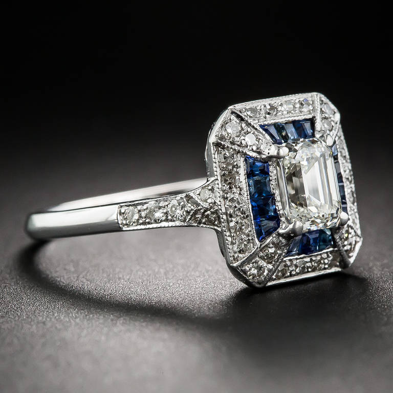 A gorgeous, classically fashioned vintage emerald-cut diamond, weighing .69 carat and accompanied by a GIA Diamond Grading Report stating: I color - VS1 clarity, radiates from within a much newer Art Deco style home recently crafted in 18K white