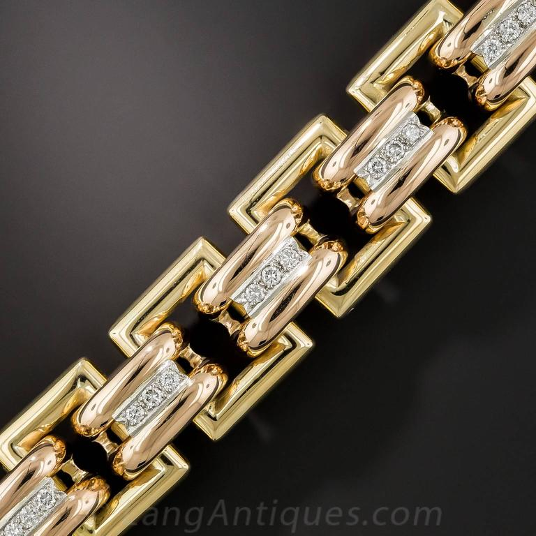 This big, bold, gleaming gold Retro wrist bauble, clocking in at an impressive 5 ounces, is substantially crafted in tri-color 18K gold: yellow gold outer links, rose gold inner links, and white gold to accentuate the center row bright-white