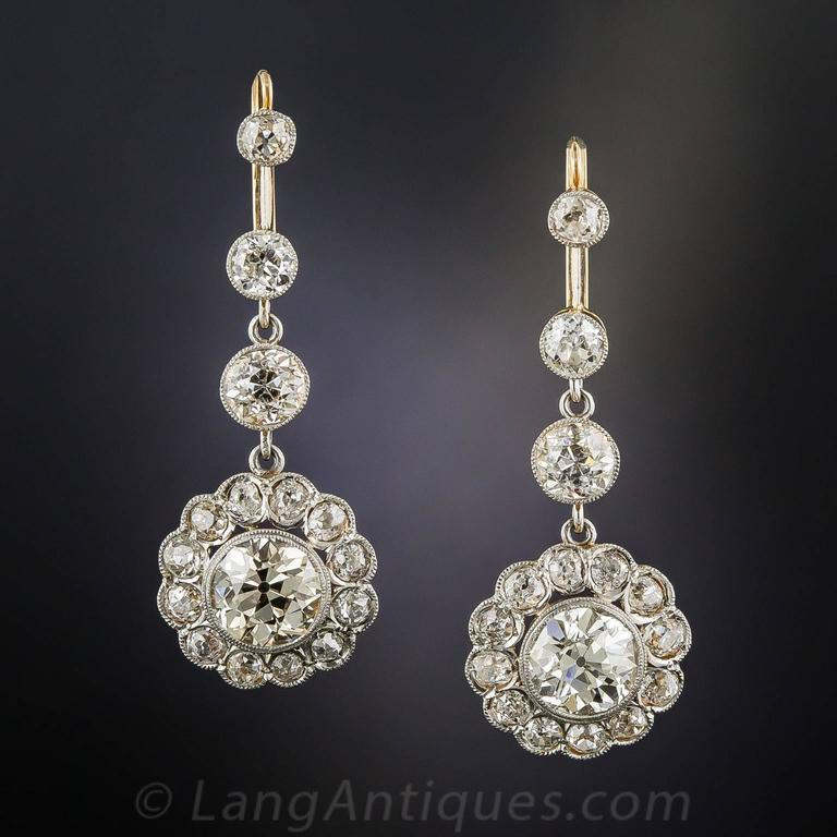 Swinging ultra-sparklers! Dating back to the early-1920s, these fabulous 1 1/2 inch long and lustrous diamond drops radiate front and center with a matched pair of gorgeous European-cut diamonds, together weighing 3.75 carats. The stones scintillate