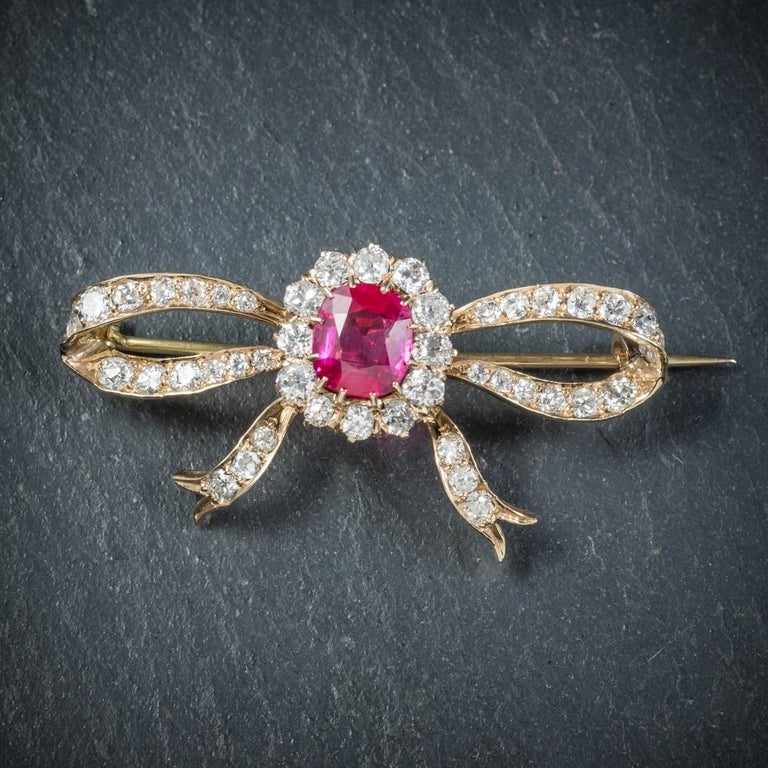 This outstanding high quality antique Ruby and Diamond brooch is Edwardian, Circa 1910  The brooch is adorned with a fabulous rich red Ruby in the centre which is an impressive 2.50ct  The rest of the bow shaped gallery is decorated in sparkling