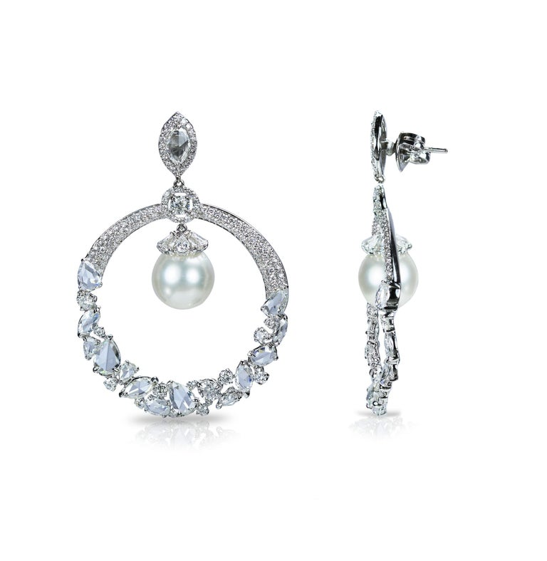 F-G-H/ VS-SI brilliant cut and rosecut diamonds and south sea pearls earrings Frost yourself with our pièce de résistance in 18K white gold featuring F-G-H/ VS-SI brilliant cut and rose cut diamonds, with delicate south sea pearls to enhance its