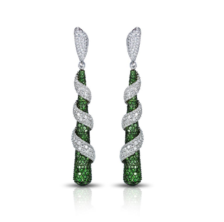 F-G/ VS Diamonds and Tsavorites Earrings  Ornate doesn't need to be over the top, and these earrings are the perfect illustration. Handcrafted with tsavorite drops alongside swirls of round brilliant cut diamonds set in 18K yellow and white gold,