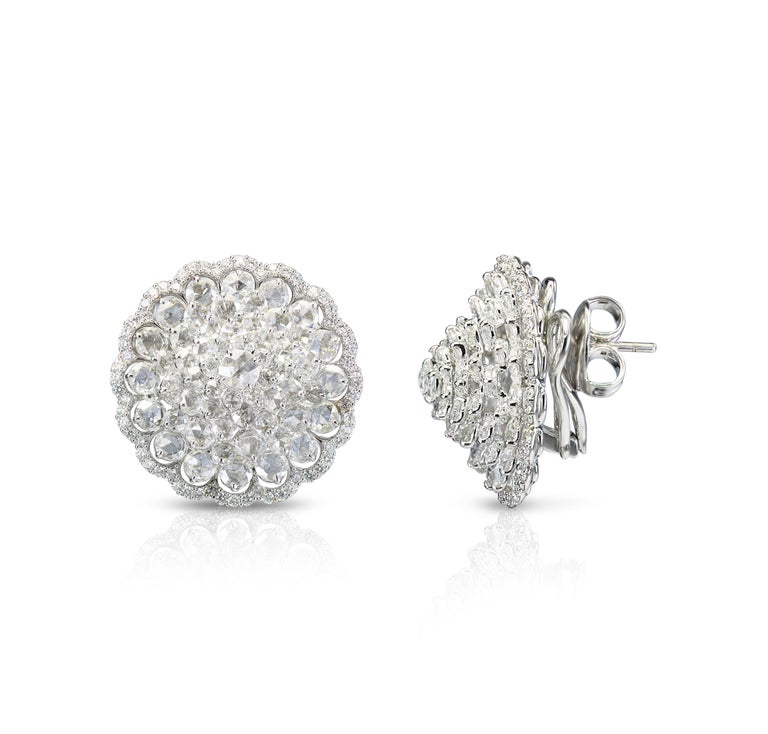 Brilliant cut and rosecut diamond Earrings  Carefully handcrafted, delicately cut and effortlessly elegant, this 18K white gold statement earrings are a collector-friendly piece of jewellery. Using the prong setting, the earrings features 242