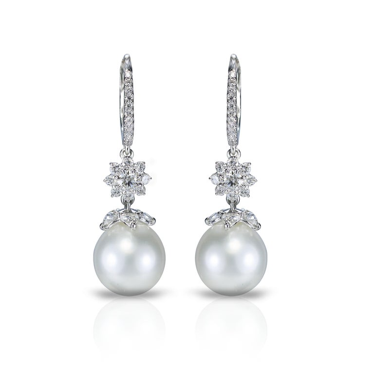 Diamond and south sea pearl earrings  Vintage sensibilities have a distinct charm as is illustrated by this pair of 18K white gold earrings featuring pear rosecut and round brilliant cut diamonds and classic south sea pearls.  Though understated,