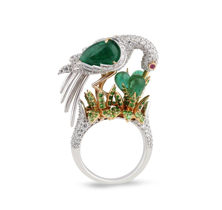 Diamonds, Emeralds, Tsavorites and Pink Sapphire Cocktail Ring  This cocktail ring is all you need to spread your wings as a bonafide style maven, thanks to its decadent crane centerpiece. Handcrafted an 18K white gold base and a bed of handpicked