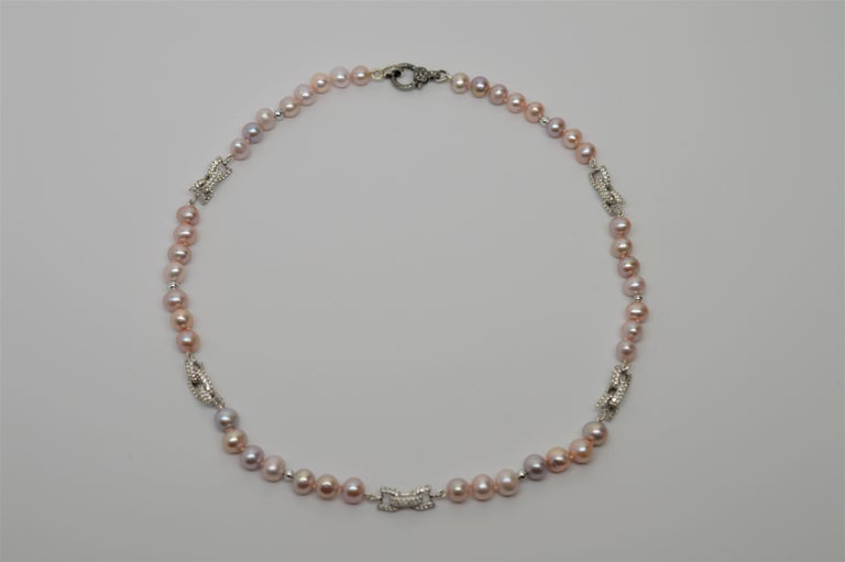 Natural Baroque Blush Color Akoya Pearl 16 inch Necklace with fabulous Sterling Silver and White Sapphire encrusted Bow Tie adornments. Ultra feminine and fitted with a decorative Diamond & Sterling Silver Clasp. Gift Boxed. An original design from