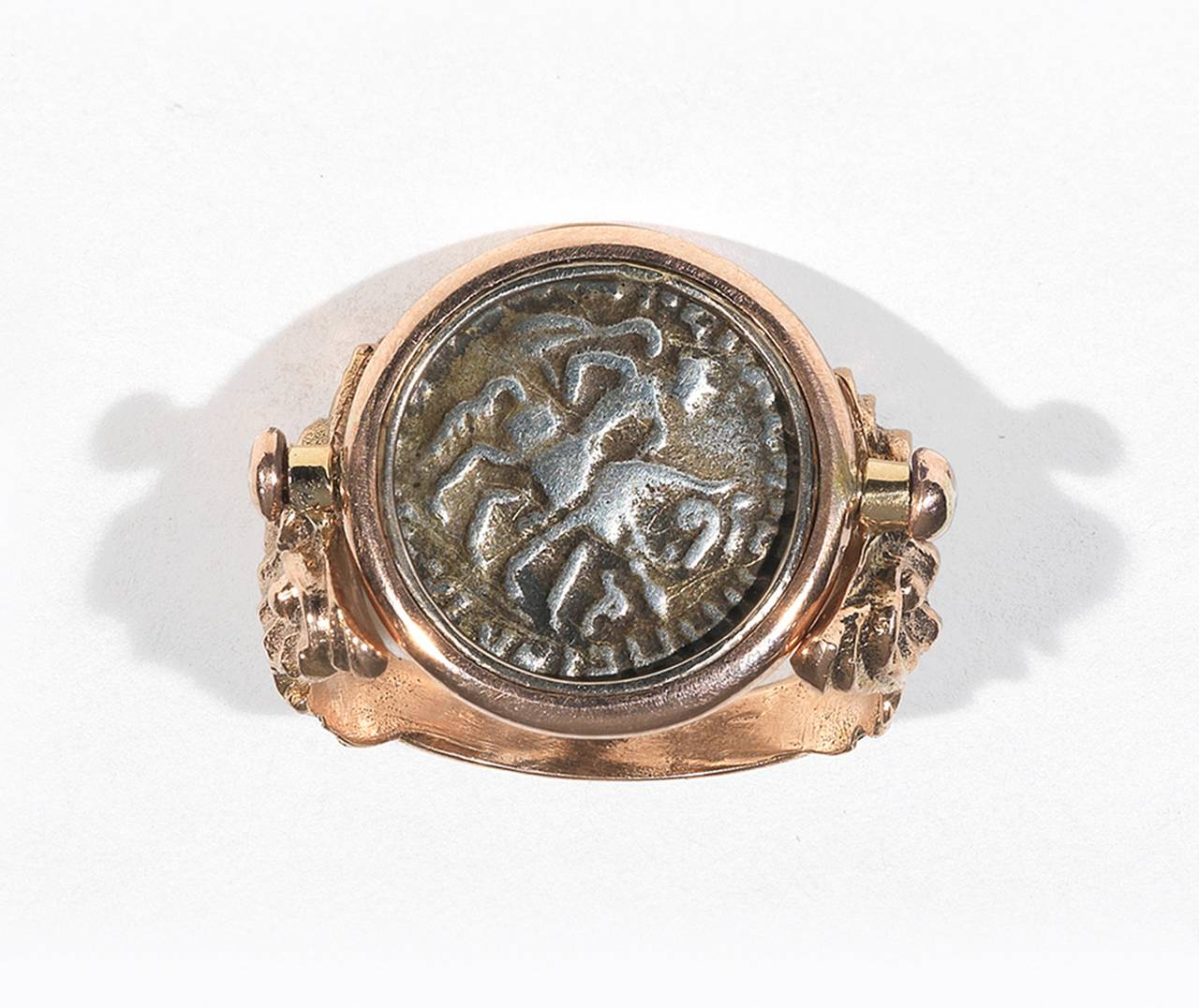 PLEASE NOTE: OUR PRICE IS FULLY INCLUSIVE OF SHIPPING, IMPORTATION TAXES & DUTIES.  Indo-Greek Ellenistic Drachm, circa 1st century A.D.   Mounted in chased shoulders 18Kt red gold setting  Finger size: 7 Weght: 9.8 gr