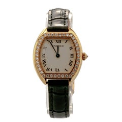 Cartier Ladies yellow Gold Diamond Tonneau Tortue Manual Wristwatch, c 1980