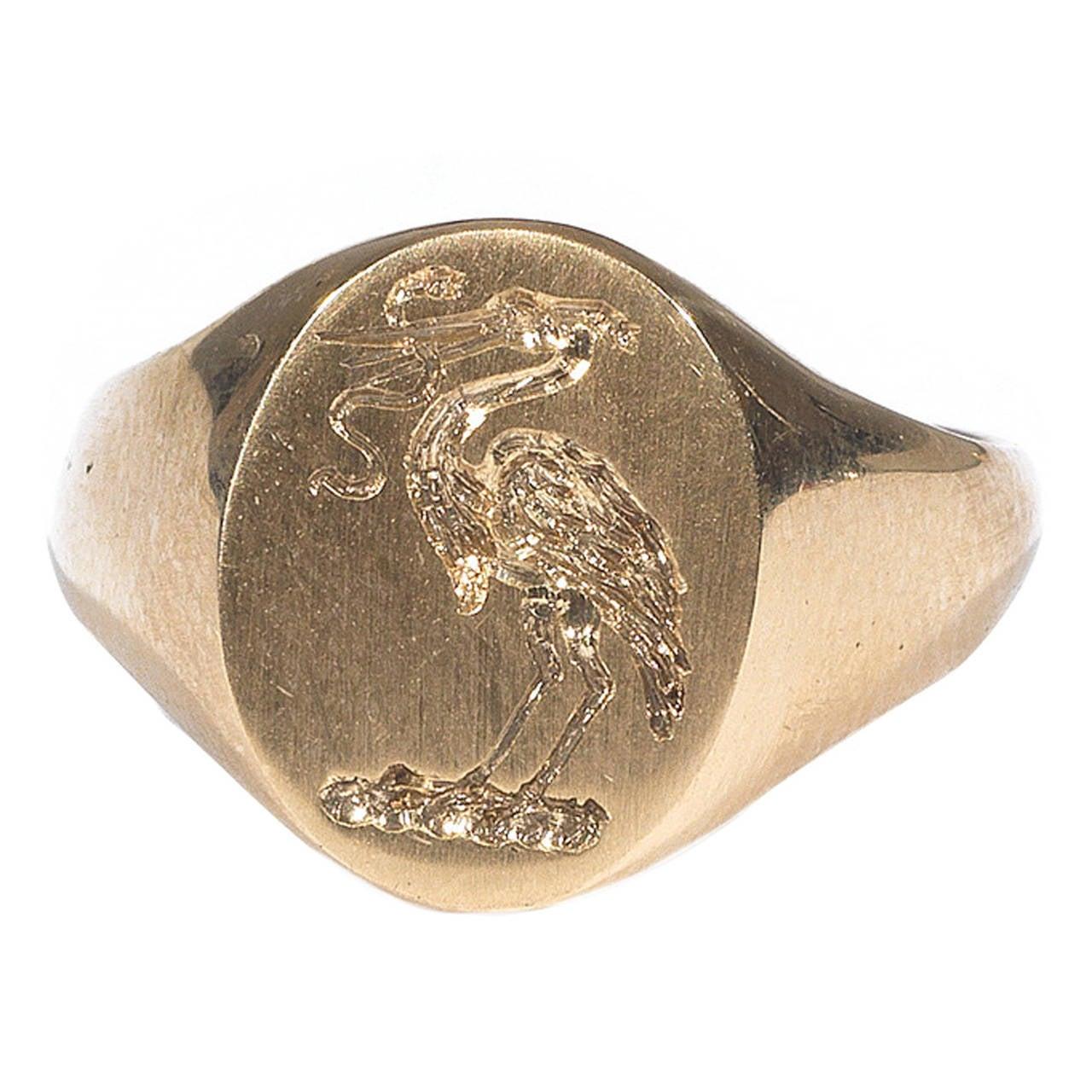 Gold Signet Stork and Snake Ring 1