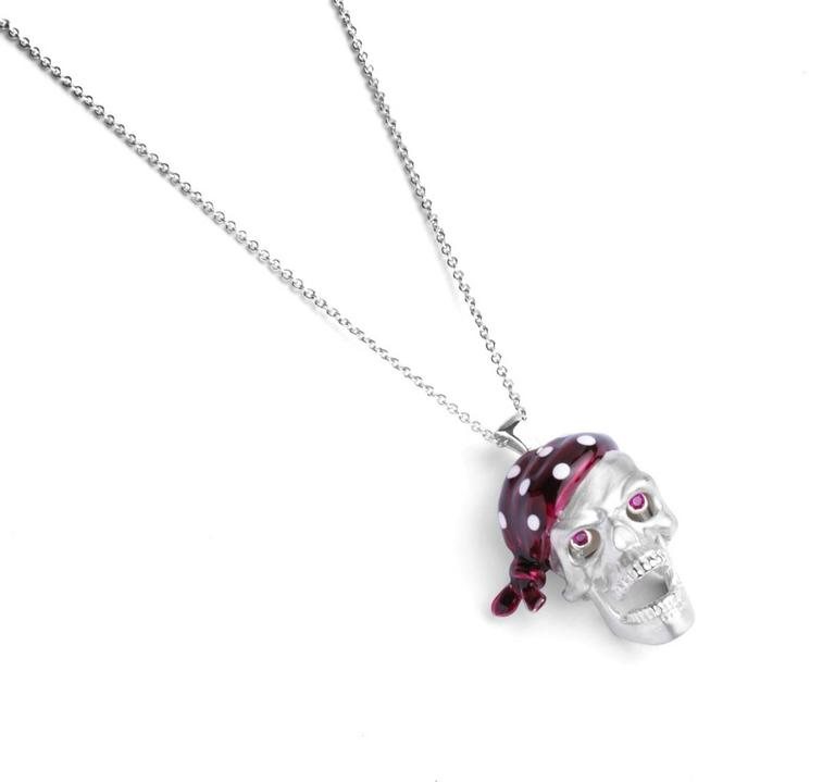 PLEASE NOTE: OUR PRICE IS FULLY INCLUSIVE OF SHIPPING, IMPORTATION TAXES & DUTIES. The sterling silver pirate skull pendant has a n opening jaw and popping ruby eyes. With a red enamel bandana it is fitted on to a 15