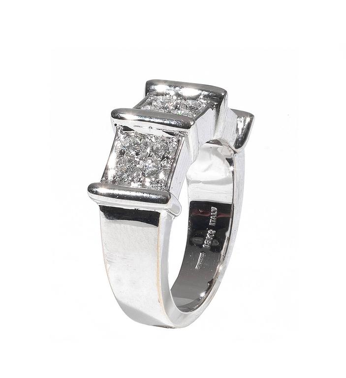 Designed as a band divided in three section set with claw set round cut diamonds  Mounted in 18Kt white gold  Finger size: 6 1/2  Weight: 11.3 gr