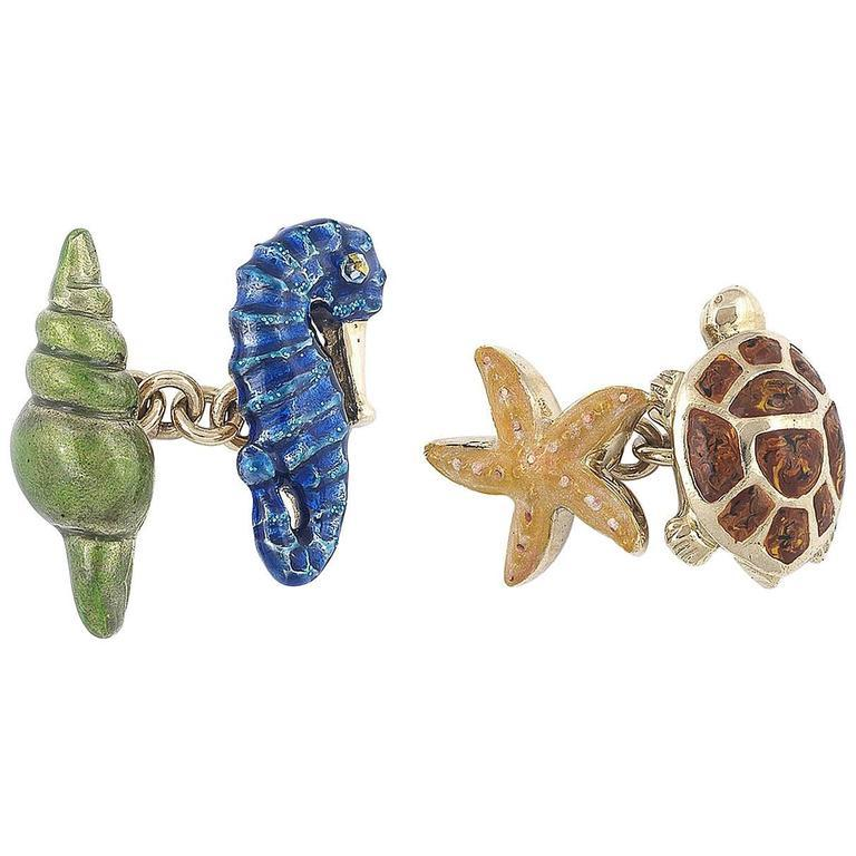 Pair of cufflinks designed as shell,seahorse,sea star and sea turtle applied with yellow, blue, brown and green translucent enamel.   Gold chain link connections.     Mounted in 18Kt yellow gold