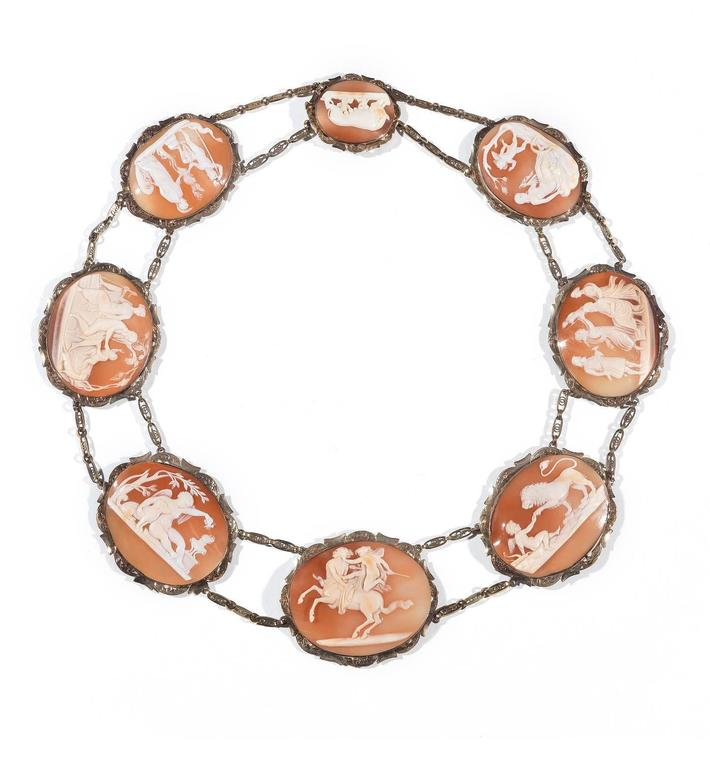 The necklace composed of eight shell cameos each carved to depict a classical scene, taken from works of Classic antiquities and Antonio Canova, including 'The Education of Bacchus', 'The Birth of Minerva', 'Love and Psyche' and 'Romulus and