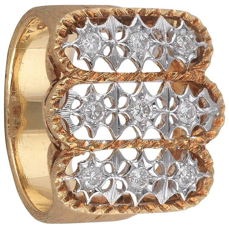 Yellow Gold with a satin mat finish and 9 small Diamonds, size 7, weight 11,1 gr.
