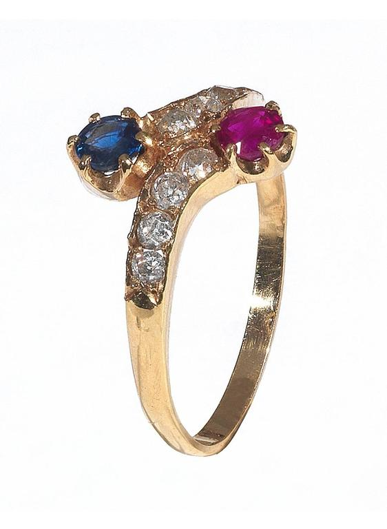 The claw set round cut sapphire and ruby to the old cut diamond set half hoop.  Mounted in 15Kt yellow gold  Weight: 1.7 gr  Finger size: 7