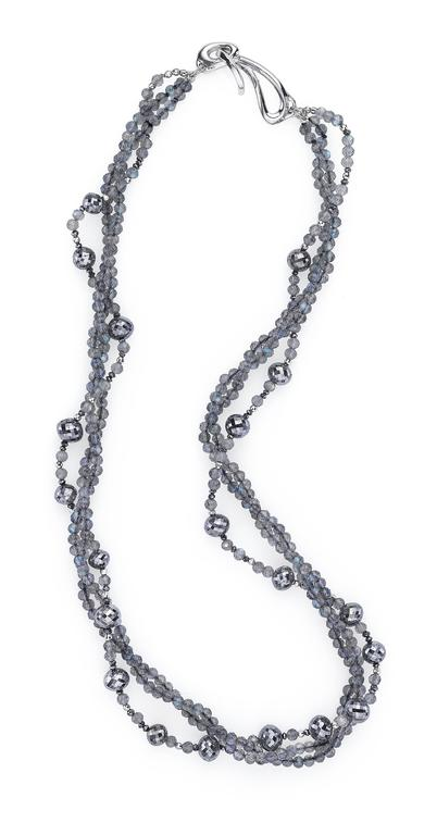 Gorgeous scintillating labradorite and 45 cts of black diamond beads strung with 14K mirrored white gold spacers. Finished with Sarna's signature clasp in 18K white gold.   Labradorite beads: 3 mm Large black diamond beads: 5.5-7 mm Small black