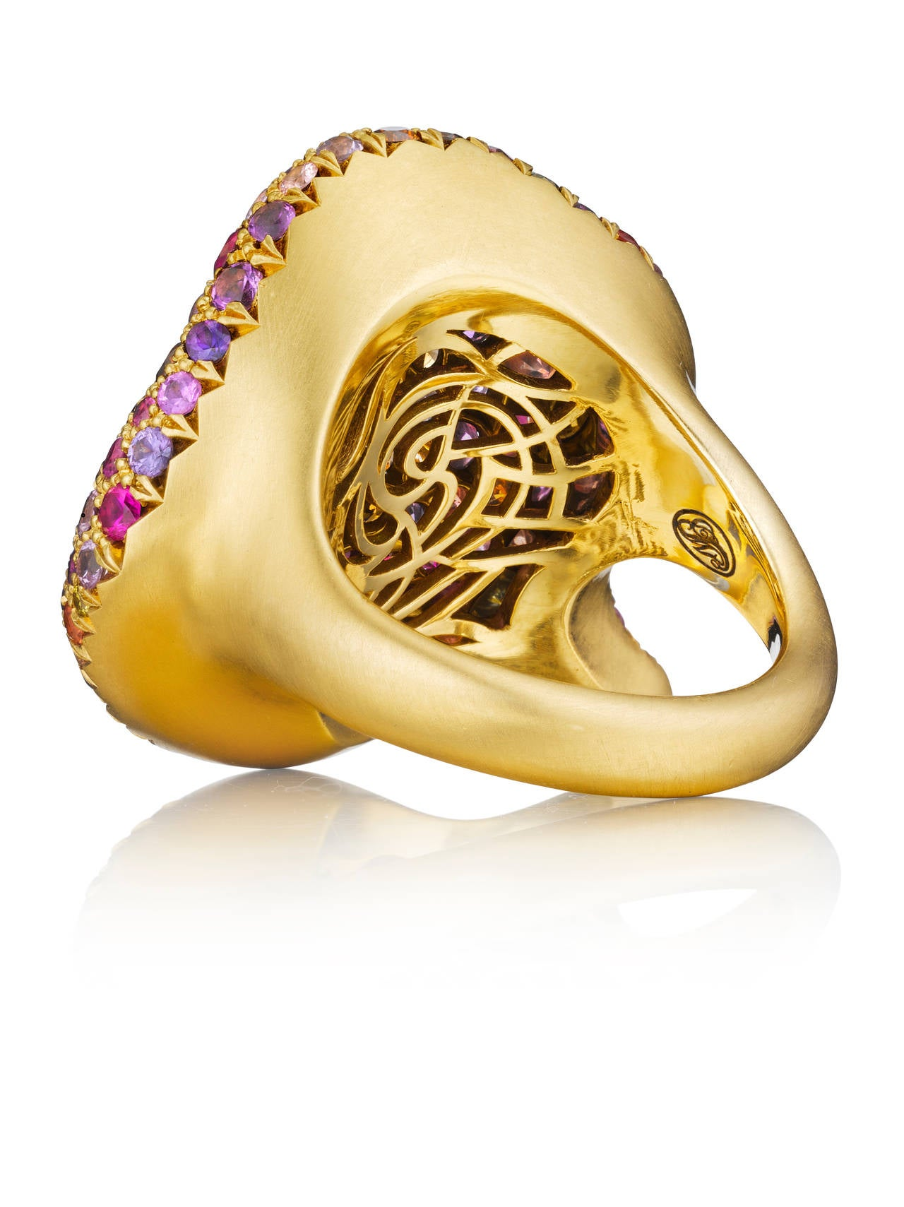 This magnificent one-of-a-kind 20K gold petal ring is set with stunning, vibrant diamonds, amethysts, garnets, rubies, and sapphires. The back of the ring is finished with Naomi Sarna's signature grill.   Internationally award winning designer Naomi