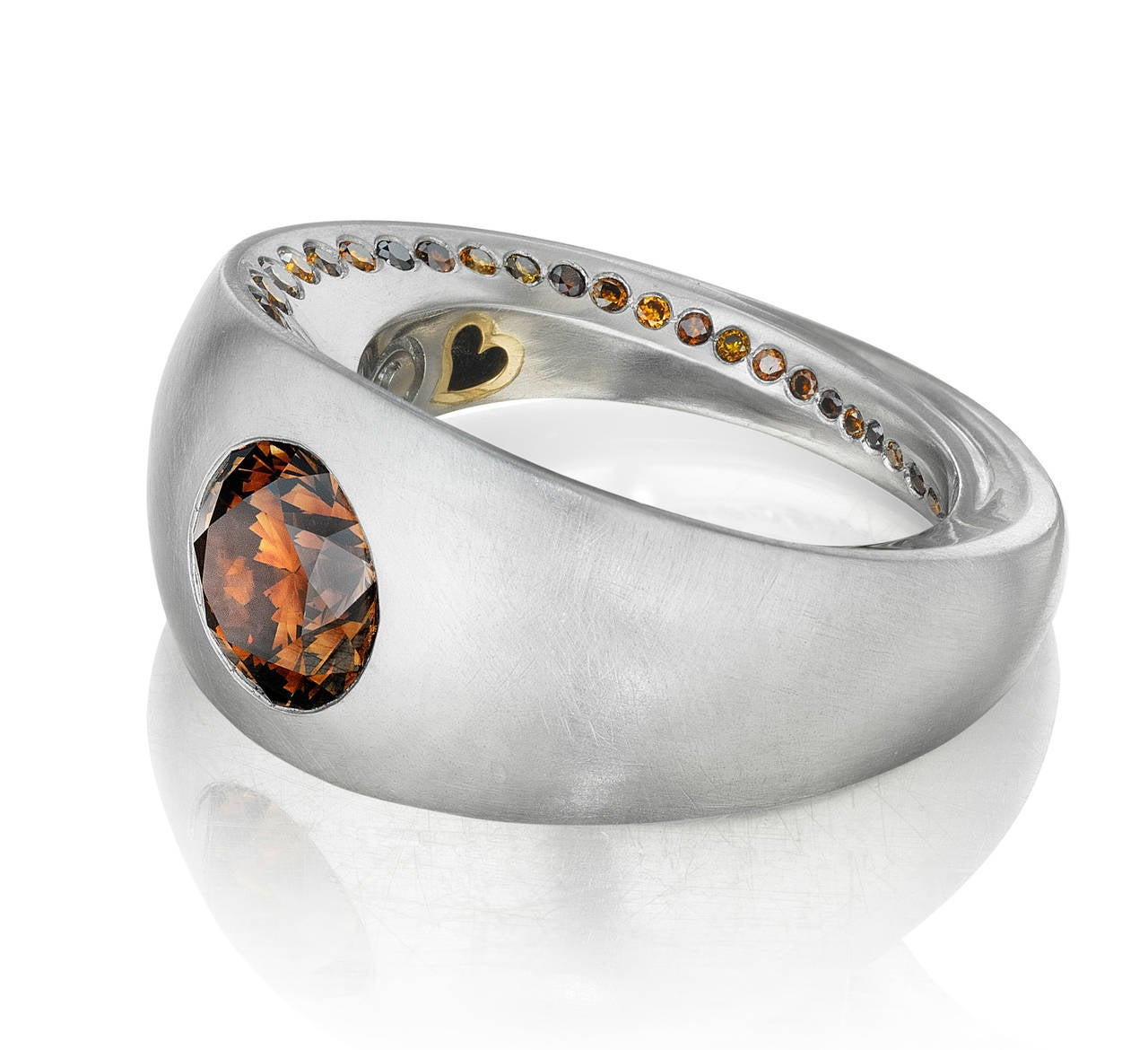 This magnificent ring won Platinum Honors in the prestigious American Gem Trade Association 2015 competition. The central diamond is a 3.17 ct GIA certified natural fancy orangey brown diamond. This stunning diamond is set in platinum with an