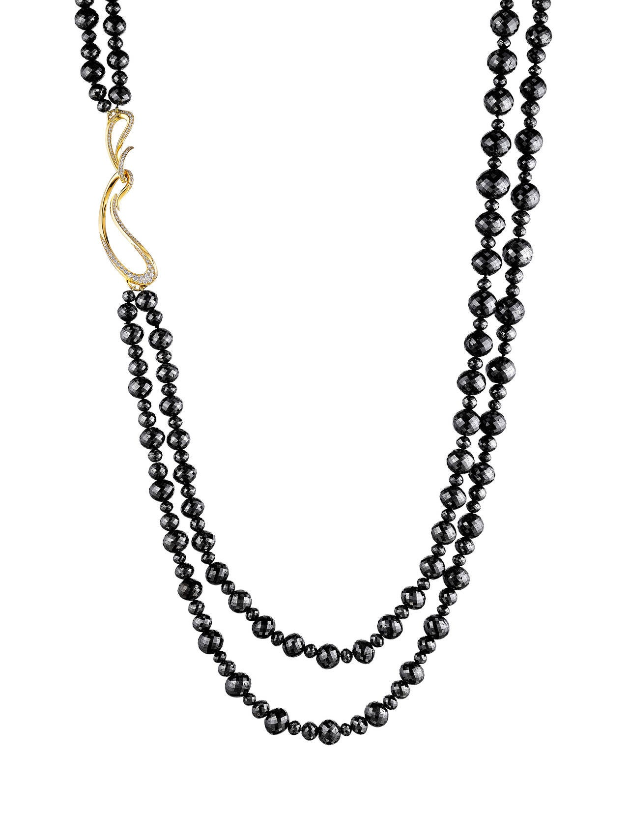 This spectacular double-strand necklace has approximately 770 ct of scintillating 4-11 mm black diamond beads. It is finished with Naomi Sarna's signature 18K yellow gold clasp set with beautiful VS-F-G white diamonds. This necklace can be doubled