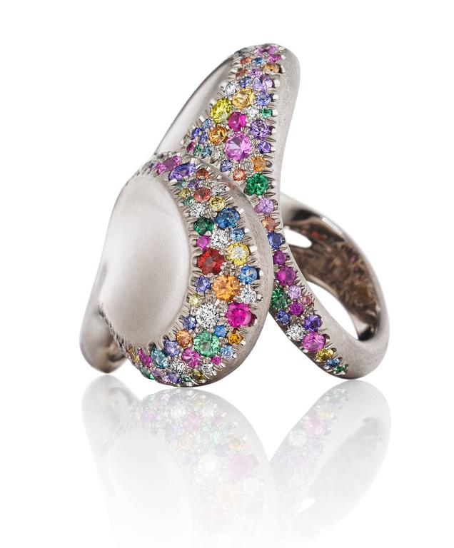 Naomi's award winning Confetti Heart Ring which was recently on display at the AGTA Spectrum Awards Gala.  An exuberance of joy and color. The Confetti Heart Ring leaps into sophisticated extravagance. Made entirely of natural 18K white gold with