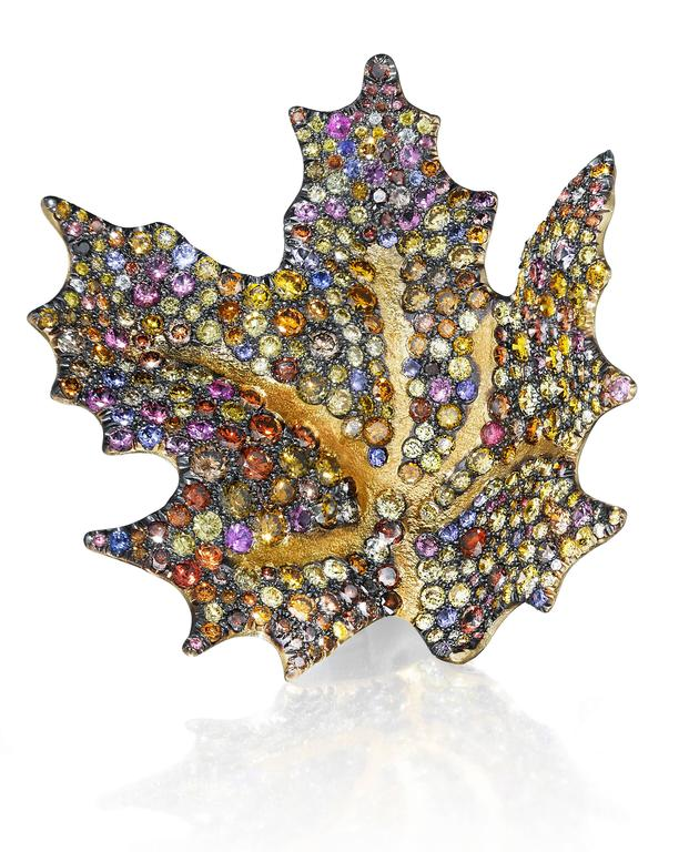 These earrings two 2017 AGTA Spectrum Awards.  Best Use of Color and Evening Wear Second Place.  Extraordinary, one-of-a-kind, award winning art jewels, the Maple Leaf Earrings are hand-crafted 18K yellow gold with 24K gold stippled veins. Each are