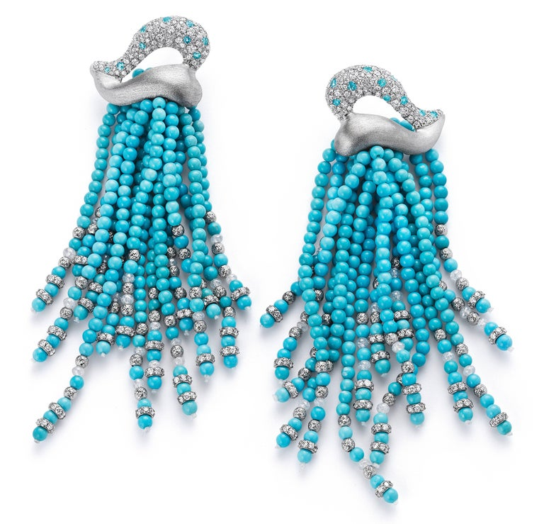 Bright and sassy, these tassel earrings feature American Sleeping Beauty Turquoise, the finest American turquoise, strung with sparkling white diamond beads and custom made white diamond and 18K white gold rondelles. The tops are 18K white gold