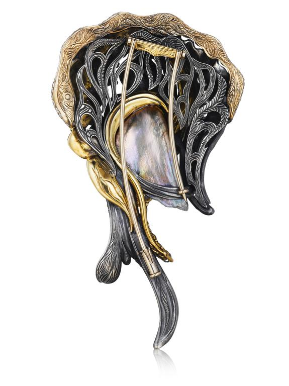 This magnificent one of a kind brooch features a natural GIA certified Chinese freshwater pearl. The pearl is accentuated with beautiful layers of platinum, 18K yellow gold, 18K white gold, and sterling silver. The various fine metals are set with