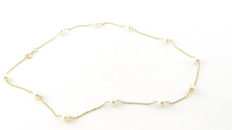 Vintage 14 Karat Yellow Gold and Pearl Necklace-This stunning necklace features 11 cultured pearls (5-6 mm each) set on a delicate 14K yellow gold necklace. Size: 16 inches Weight: 2.9 dwt. / 4.6 gr. Stamped: 14K Very good condition, professionally