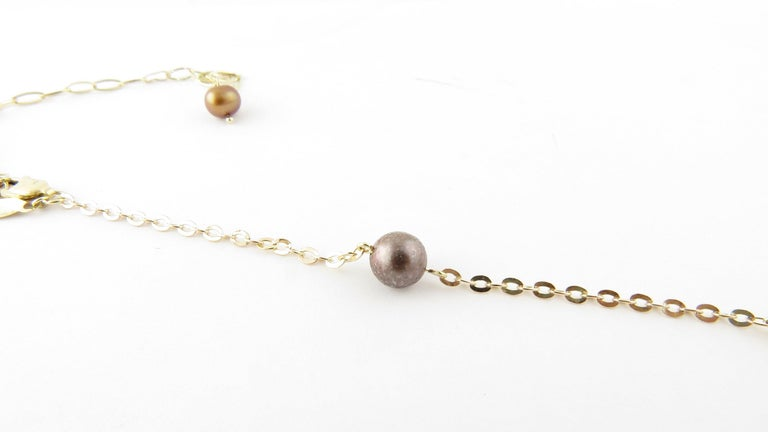 Vintage 14 Karat Yellow Gold Grey Pearl and Citrine Necklace- This lovely necklace features four round citrines, five 7 mm grey pearls and one 6 mm grey pearl. Set on a classic 14K yellow gold chain. Size: 20.5 inches to 24.5 inches Weight: 4.3 dwt.