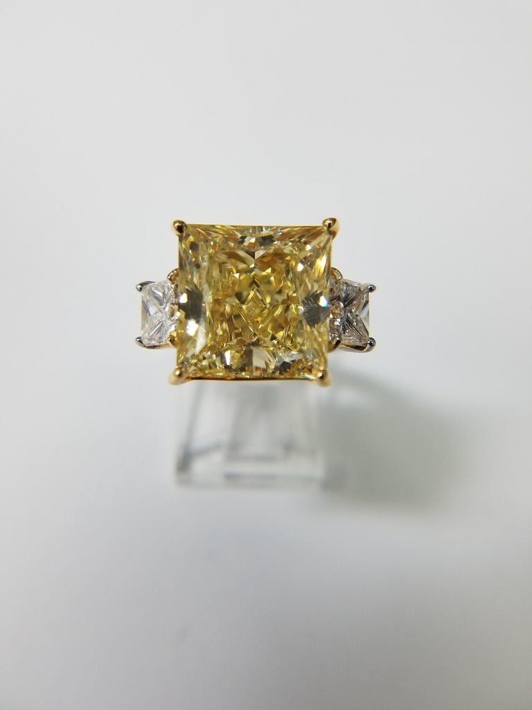 We bring you another Louis Newman & Company creation. If you want something big, shiny and yellow for a great price point, this is it. GIA Certified 11.11 carat princess cut diamond with a VS1 clarity and Natural Fancy Yellow. Mounted in a Platinum