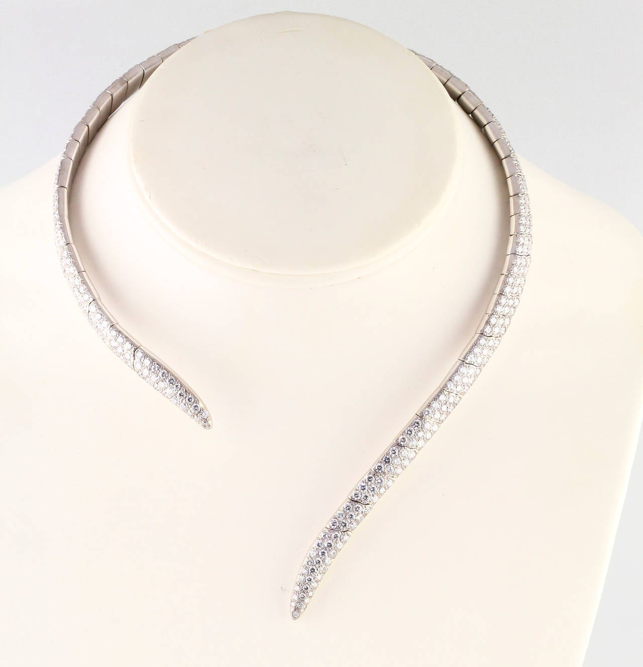 Impressive and bold diamond and 18K white gold necklace by Boucheron. It features very high grade round brilliant cut diamonds, approx. 18.0-20.0cts total weight. The flexible nature of its design displays a modern aesthetic yet comfortable