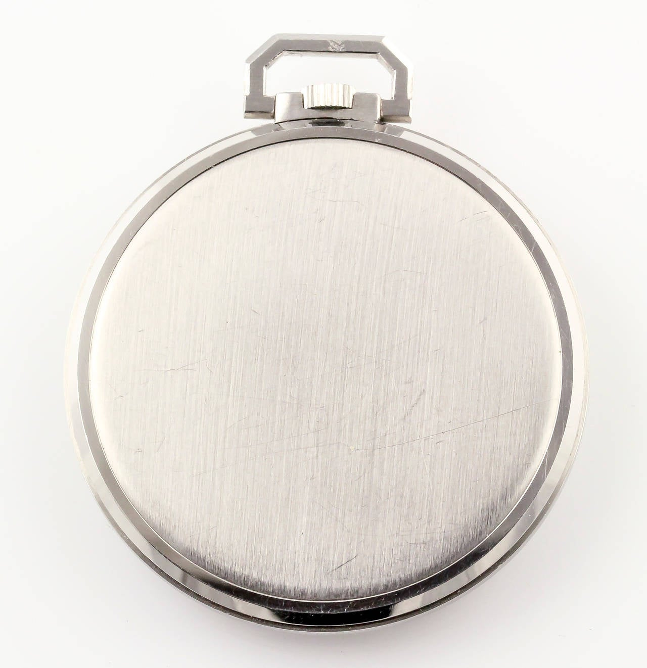 Elegant diamond and platinum pocket watch by Patek Philippe, circa 1960s. It features very high grade round and baguette cut diamonds at each hour. Manual wind movement.  Ref. 600. Recent model sold for over $21000 at Christie's Watches online