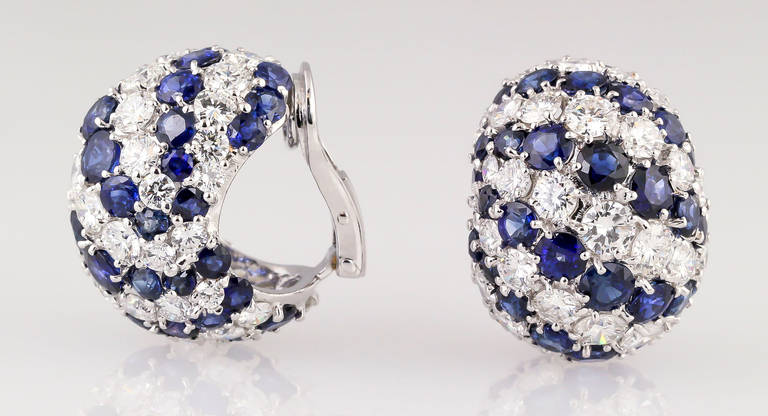 Chic sapphire and diamond earrings, set in 18K white gold, of Italian origin. They feature approx. 8.0-9.0cts of very high quality round brilliant cut diamonds, F-G color range, VVS to VS clarity range; as well as 9.0-10.0cts of rich blue