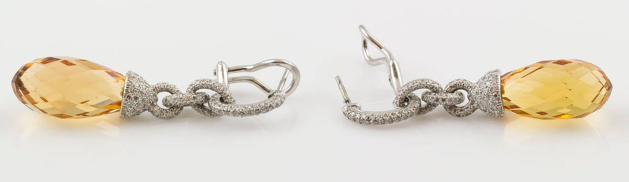 Stylish platinum and beryl briolette earrings by Tiffany & Co., They feature very high grade round brilliant cut diamonds. Hallmarks: T&CO., PT950, reference numbers.