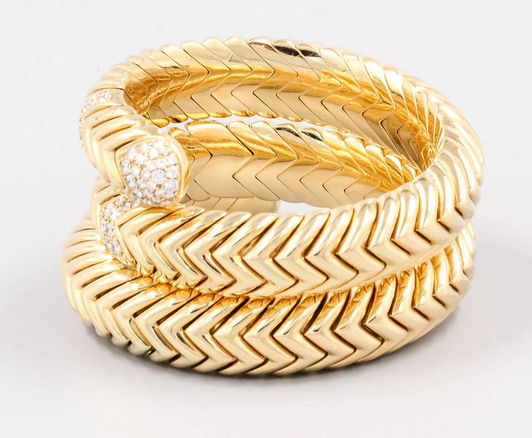 """Timeless diamond and 18K yellow gold snake bracelet, from the """"Spiga"""" collection by Bulgari. It features very high grade round brilliant cut diamonds of approx. 4.5 carats. Exquisite workmanship in this bracelet, which also features a"""