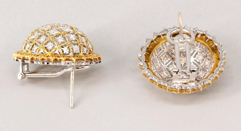 Elegant and intricate large diamond and 18K yellow & white gold dome earrings by M. Buccellati. They feature high grade round brilliant cut diamonds throughout the dome, with intricate yellow gold around the edge and white gold as the rest of the