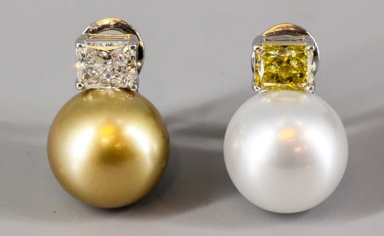 Beautiful diamond, pearl and platinum earrings. They feature rectangular cut very high grade diamonds, one of which is fancy vivid yellow with a total weight of 1.54 cts and VVS2 clarity, while the other is G color, VS1 clarity with a total weight
