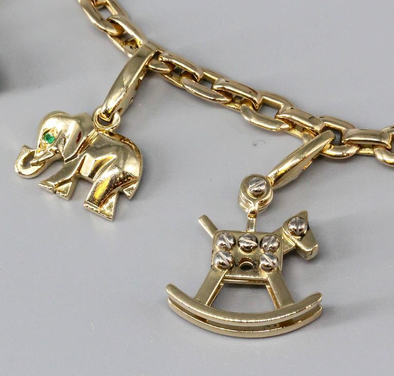 Women's Cartier Ten-Charm Gold Bracelet For Sale