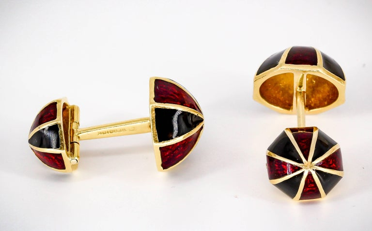 Handsome enamel and 18K yellow gold cufflinks by David Webb circa 1970s. They feature an alternating pattern of red and black enamel.  Very handsome and easy to put on.  Hallmarks: Webb, 18k.