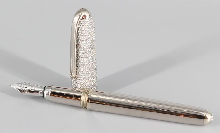 "Very fine and exceptionally rare diamond and 18k white gold fountain pen from the ""Louis Cartier"" collection, by Cartier. Limited edition of 10 pieces believed to be in existence today. Approx. 18.0-22.0 carats of very high grade round brilliant cut"