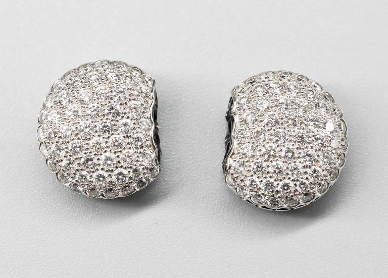 "Elegant white diamond and 18K white gold stud earrings from the ""Macaron"" collection by Boucheron. These whimsical earrings are designed in the likeness of the popular French Macaron cookie. They feature high grade round brilliant cut"