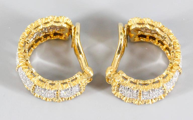 Elegant diamond and 18K white and yellow gold ear clips by Buccellati. They feature high grade round brilliant cut diamonds in a pave type setting. Beautiful intricate workmanship customary to Buccellati.  A stunning and easy to wear set of