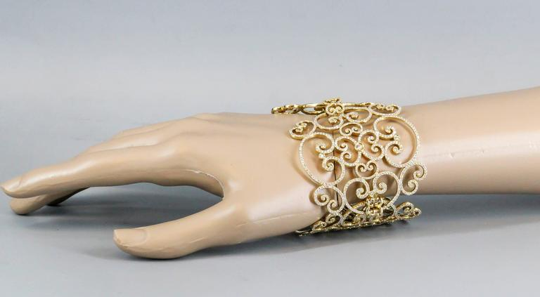 Interesting and unusual diamond and 18K yellow gold large link bracelet by  Paloma Picasso for Tiffany & Co.  Inspired by the iron wrought gates of Venice, this stunning bracelet offers both opulence and charm.  Made for the Goldoni collection,
