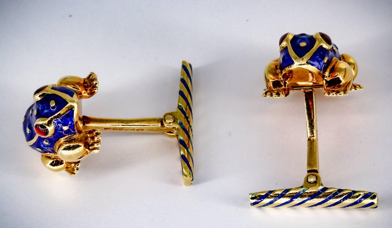 Interesting enamel gold cufflinks by David Webb, circa 1970s. They resemble frogs, with rich red for eyes and blue enamel accents over an 18K yellow gold body. Beautifully made and easy to wear.  Hallmarks: Webb, 18k.