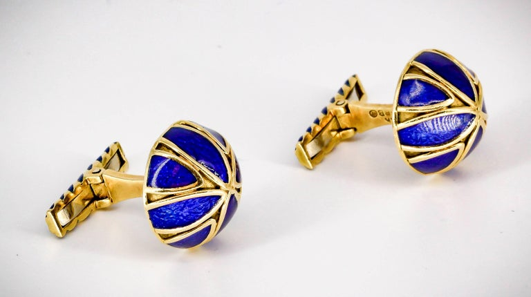 Elegant blue enamel and 18K yellow gold cufflinks by David Webb. They feature blue enamel accents over a yellow gold setting. Handsome make and easy to wear.  Hallmarks: Webb, 18k.
