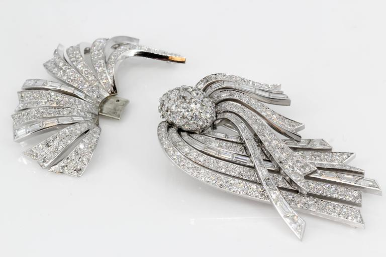 "Impressive diamond, platinum and 18K white gold large traveling brooch by Lacloche Paris, circa 1920s. This is a one piece brooch that can be separated into two pieces for day or night wear, commonly referred to as ""traveling jewelry""."