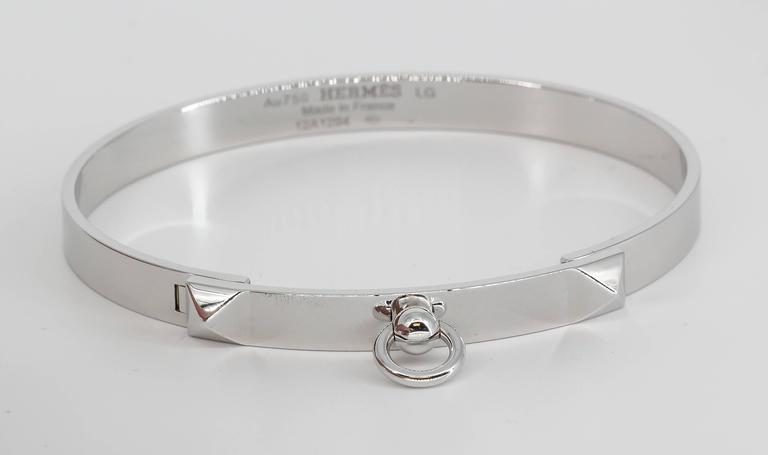 "Cool 18K White Gold bangle bracelet from the ""Collier de Chien"" collection by Hermes. Large size.  Current retail $7500.  Hallmarks: Hermes, AU750, reference numbers, French 18K gold assay mark, maker's mark."